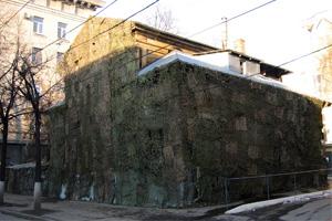 Скрыть фасад здания с помощью комуфляжной сети